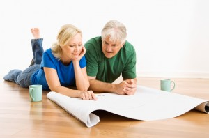 couple reviewing construction plans