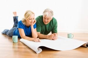 couple discussing blueprints.