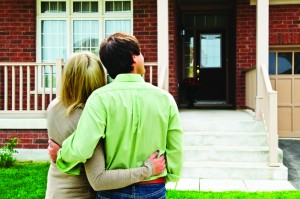 couple looking at custom built home