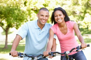 Young African American Couple Cycling