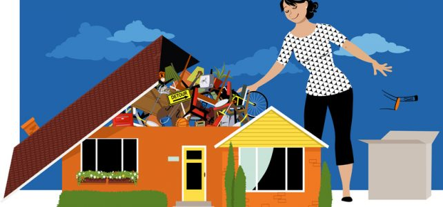 Woman decluttering, throwing away things from a house